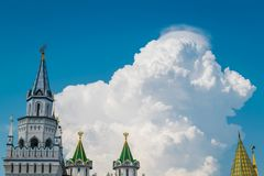 Beautiful huge cloud in blue sky with castle as foreground. royalty free stock images