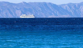 Beautiful huge cruise ship in sea. Mountains in background. Aegean , Greece Rhodes. Stock Images