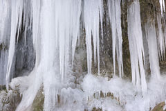 Beautiful and huge icicles in river cascade Stock Photography