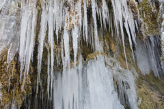 Beautiful and huge icicles in river cascade Stock Photo