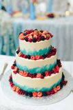 Beautiful huge wedding cake with flowers and fruits royalty free stock photography