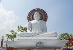 Beautiful huge white statue of Buddha on the roof of the temple in Colombo. In Sri Lanka stock images