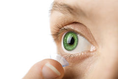 Beautiful human eye and contact lens isolated. On white royalty free stock photography