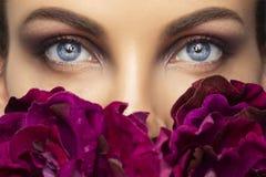Beautiful human eyes close-up. Young Woman Blue eyes macro shoot. Macro Closeup eye with peony flowers. Beautiful human eyes close-up. Young Woman Blue eyes royalty free stock photo