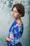 Beautiful, humble girl with a weave on her head , posing for the camera Royalty Free Stock Photo