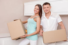 Beautiful husband and wife are packing things for Royalty Free Stock Images