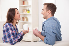 Beautiful husband and wife are resting at home Stock Images