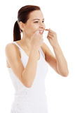 Beautiful hygiene woman with dental floss. Stock Photo