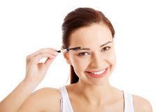 Beautiful hygiene woman with eye brush. Royalty Free Stock Images