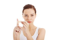 Beautiful hygiene woman with plaster on finger. Stock Photo