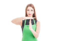 Beautiful hypermarket employee with time out gesture Royalty Free Stock Photos