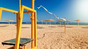 Beautiful iamge of empty volleyball field on the sea beach at bright sunny windy day. Sports on summer holiday vacation. Beautiful iamge of empty volleyball stock photos