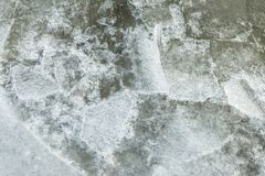 Beautiful ice with abstract cracks. Royalty Free Stock Image