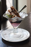 Beautiful ice cream. In a glass top on a wooden table Stock Photo