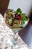 Beautiful ice cream. With fresh strawberries and mint Royalty Free Stock Image