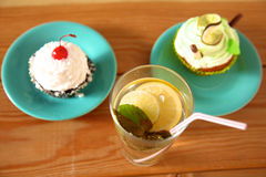 Beautiful ice cream and drinks on the wooden table Stock Photography
