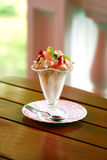 Beautiful ice-cream in glass. With fruits and chocolate stock image
