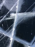 Beautiful ice surface with cracks on frozen Lake Baikal. The natural background. stock photos