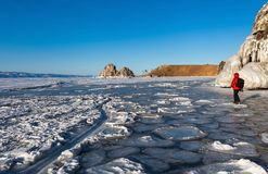 Beautiful ice surface texture in front of Shaman rock,Baikal Royalty Free Stock Images