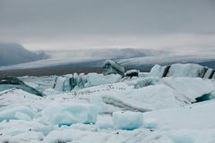 Beautiful icebergs, glacier and snow-covered hills. In iceland royalty free stock photos