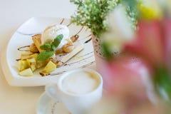 Beautiful icecream dessert breacfast coffee composition tiramisu flowers Royalty Free Stock Image