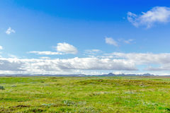 Beautiful Icelandic landscape with mountains, sky and clouds Royalty Free Stock Photo