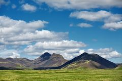 Beautiful Icelandic landscape with volcano, mountains, sky and clouds. Royalty Free Stock Images