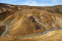 Beautiful Icelandic landscape in wizarding mountains. Kerlingarfjöll, Iceland. Beautiful Icelandic landscape in magical mountains. The mountains are rainbow Stock Photos