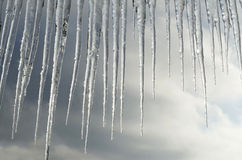 Beautiful icicles on a background of clouds Royalty Free Stock Photos