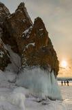 Beautiful icicles on rocks at sunrise. Winter landscape in Lake Baikal. Stock Photos