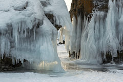Beautiful icicles on rocks. Royalty Free Stock Photos