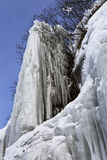 Beautiful icicles on rocks. Stock Photo