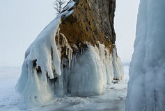 Beautiful icicles on rocks. Stock Images