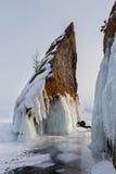 Beautiful icicles on rocks. Winter landscape in Lake Baikal. Stock Photo