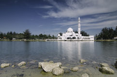 Beautiful iconic  floating mosque at Terengganu, Malaysia with blue sky background. Royalty Free Stock Photography