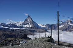 Beautiful iconic mountain Matterhorn with with railway and mist Royalty Free Stock Photos