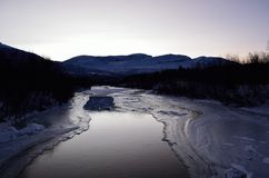 Beautiful icy river stream in wintertime. In the arctic circle Royalty Free Stock Images