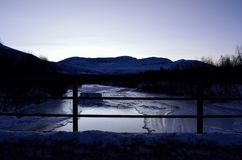 Beautiful icy river stream in wintertime. In the arctic circle Royalty Free Stock Image