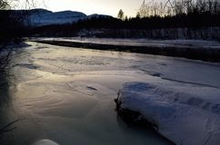 Beautiful icy river stream in wintertime. In the arctic circle Stock Image