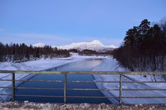 Beautiful icy river stream in wintertime. In northern norway Royalty Free Stock Photo