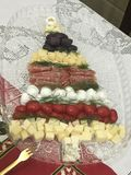 Christmans tree made by cheese and other cold food stock images
