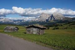 Beautiful idyllic panoramic alp and mountains in the dolomites / distinctive sassopiatto peak. Alp de siusi / sasso piatto / gardena valley / south tyrol Royalty Free Stock Photo