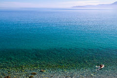 Beautiful idyllic turquoise waters shoreline. Beautiful idyllic crystal clear turquoise waters shoreline Stock Images