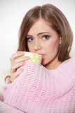 Beautiful ill woman drinking hot tea Stock Photos