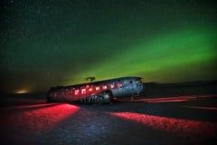 Beautiful illuminated airplane wreck on Solheimasandur, Iceland. Famous tourist place of abandoned wreck of American navy, Dakota Stock Photography