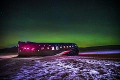 Beautiful illuminated airplane wreck on Solheimasandur, Iceland. Famous tourist place of abandoned wreck of American navy, Dakota Royalty Free Stock Photos
