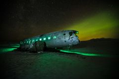 Beautiful illuminated airplane wreck on Solheimasandur, Iceland. Famous tourist place of abandoned wreck of American navy, Dakota Stock Image