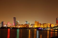 Beautiful illuminated Al Fateh Highway Highrise buildings, Bahrain, HDR photograph Stock Photos