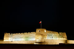 Beautiful illuminated Arad fort at night. Arad Fort is a 15th century fort in Arad, Bahrain Stock Photo
