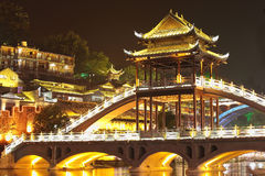 Beautiful illuminated bridge at fenghuang ancient town Stock Photos